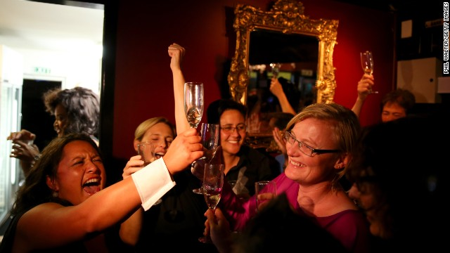 Celebrations begin at the Caluzzi Bar and Cabaret venue in Auckland after New Zealand lawmakers voted to legalise gay unions.