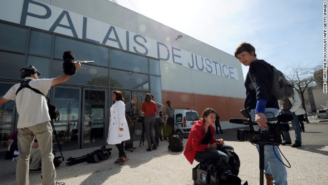 Reporters wait outside the courthouse on April 16, 2013 at the Parc Chanot in Marseille, southern France.