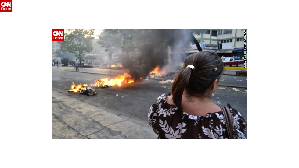 Supporters of opposition candidate Henrique Capriles Radonski have held demonstrations, blocked roads and banged pots and pans in the street, demanding a vote recount. Bastardo, who shot this photograph, says he and others are banging pots as a pacifist way of protesting.