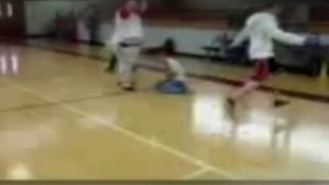 pkg substitute teacher slams ball on student head_00012324.jpg