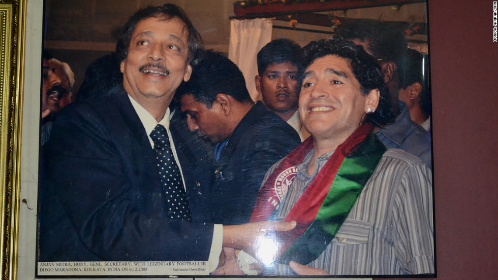 A photograph on the wall of the Mohun Bagan headquarters shows club secretary Anjan Mitra greeting legendary Argentine footballer Diego Maradona on December 6, 2008.