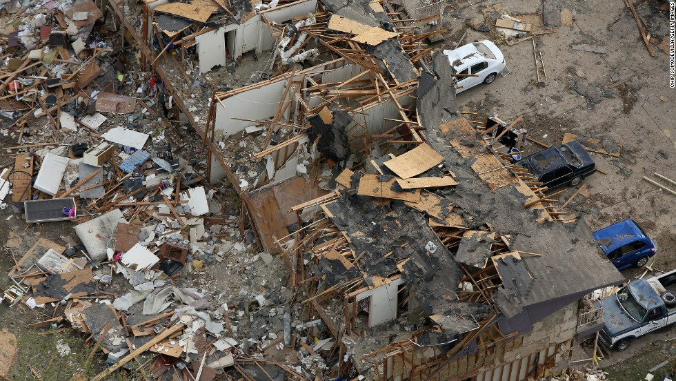 Search and rescue workers comb through what remains of a 50-unit apartment building.