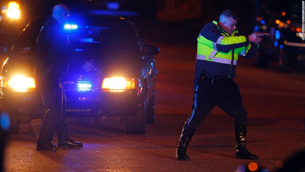 "Police officers keep a man on the ground in Watertown on Friday. <a href=""http://www.cnn.com/2013/04/19/us/gallery/boston-ghost-town/index.html"">See all photography related to the Boston bombings.</a>"