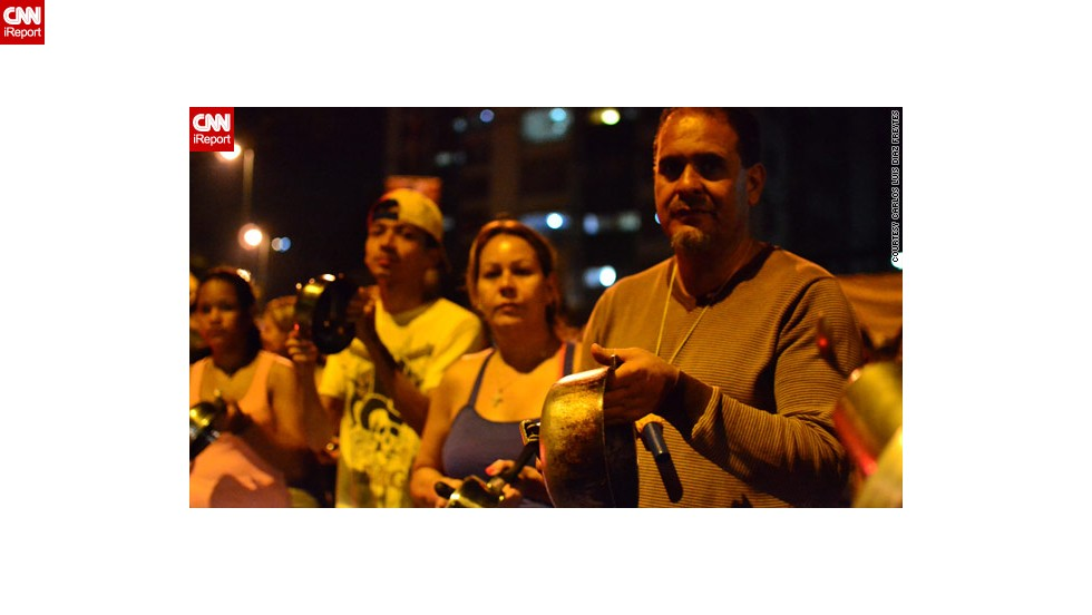 "Opposition supporters in iReporter <a href=""http://ireport.cnn.com/docs/DOC-957905"">Carlos Luis Diaz Freytes'</a> Caracas neighborhood took part in a ""cacerolazo"" -- literally ""casserole"" -- protest on Monday night."