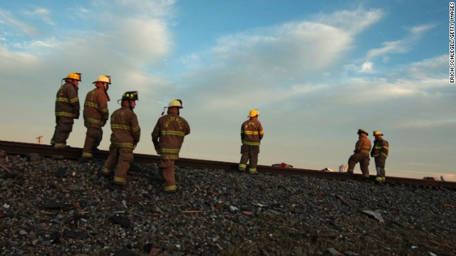 WEST, TX - APRIL 18: Valley Mills Fire Department personnel view the railroad tracks near to the fertilizer plant that exploded yesterday afternoon on April 18, 2013 in West, Texas. According to West Mayor Tommy Muska, around 14 people, including 10 first responders, were killed and more than 150 people were injured when the fertilizer company caught fire and exploded, leaving damaged buildings for blocks in every direction. (Photo by Erich Schlegel/Getty Images)