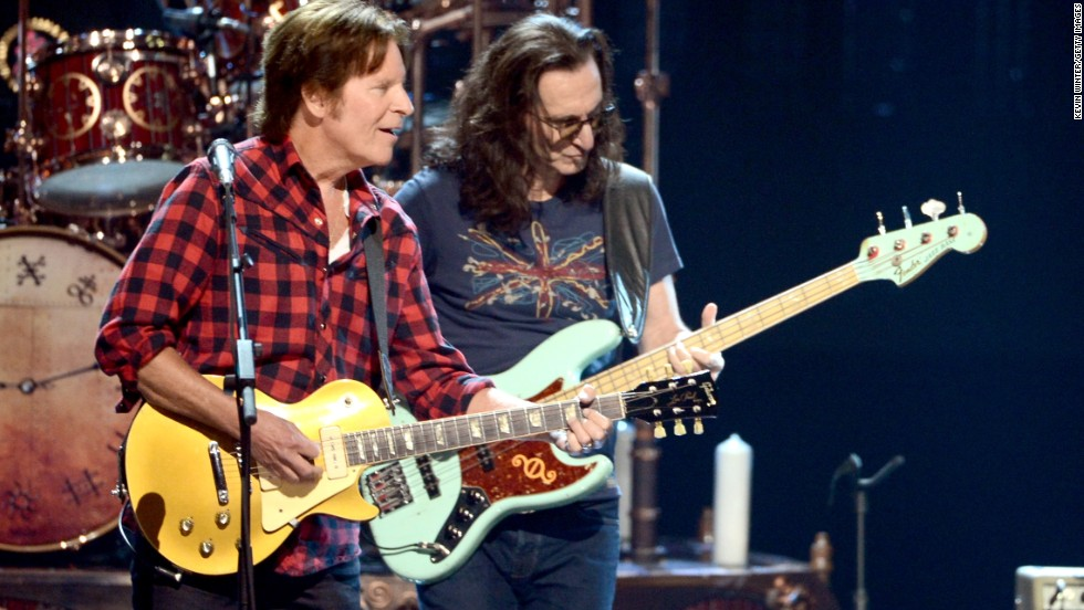 John Fogerty, left, and Rush's Geddy Lee perform together.
