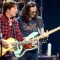 rock John Fogerty and Inductee Geddy Lee