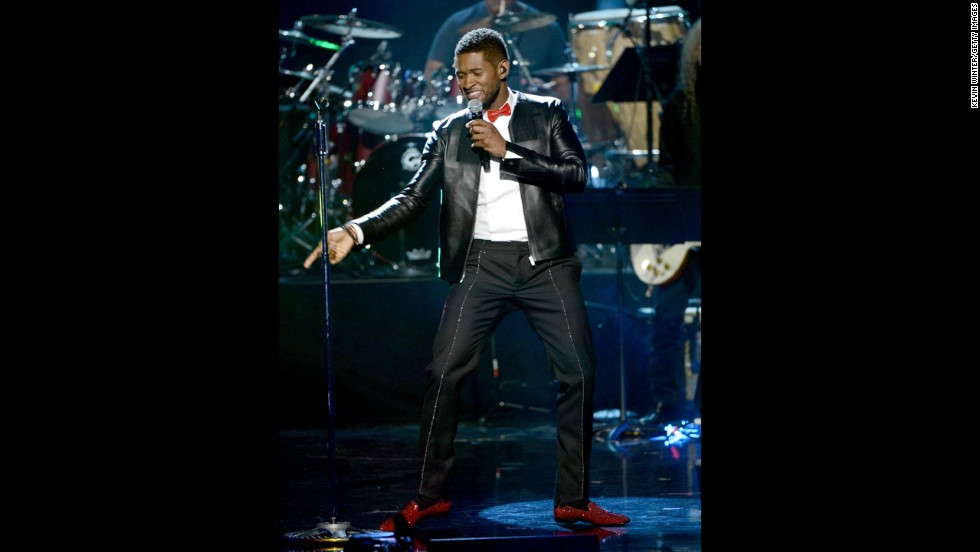 Usher performs onstage.