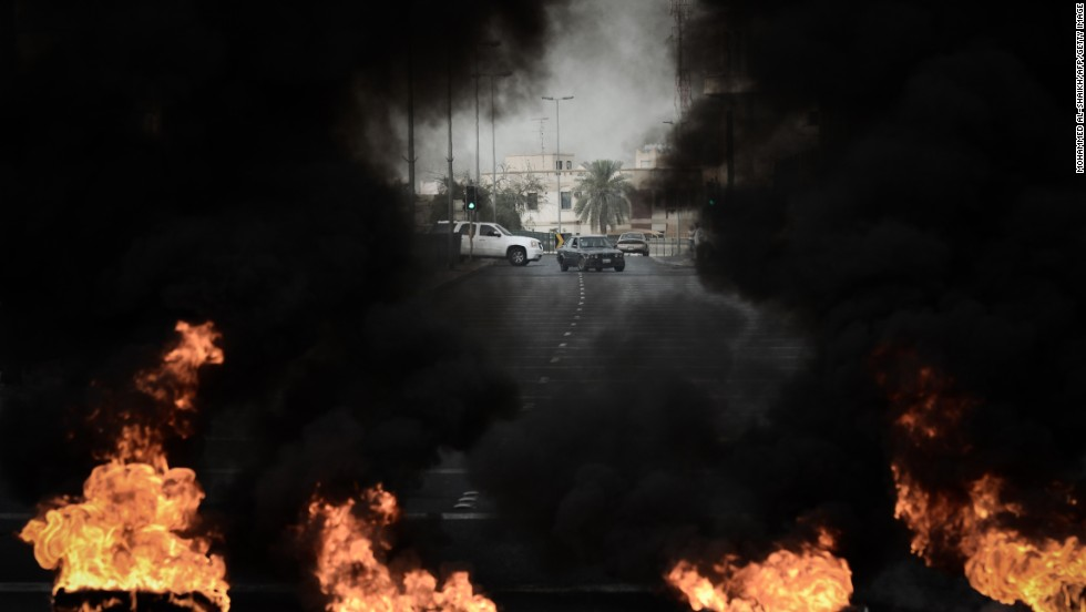 Tires placed on the road by anti-regime protestors burn during clashes with riot police in the village of Diraz, west of Manama. Bahrain riot police fired tear gas and stun grenades at protesters, who hurled petrol bombs during protests against the staging of the race.