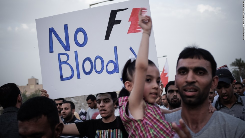 A Bahraini protestor holds up a poster against the country's upcoming Formula One Grand Prix during a demonstration in the village of Jid Ali, north-east of Isa Town. Protesters in Bahrain plan to step up demands for reform ahead of Sunday's race.