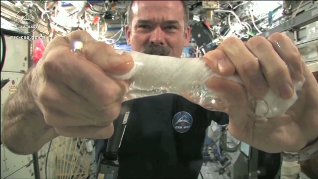 Wringing out a washcloth in zero gravity