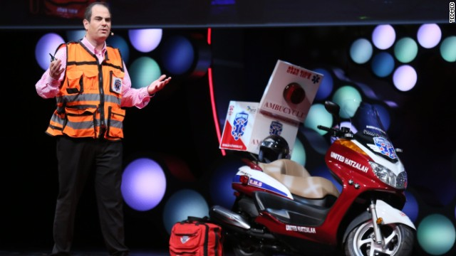 "Israeli medic Eli Beer speaks at TEDMED alongside his ""ambu-cycle."" Beer founded an all-volunteer rescue service."