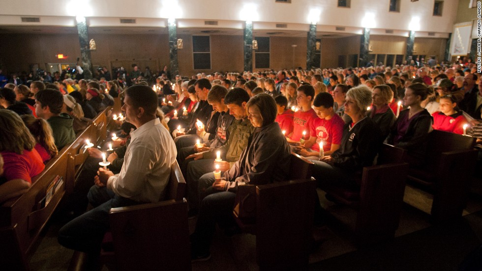 A candlelight vigil is held at St. Mary's Catholic Church in West, Texas, on Thursday, April 18.