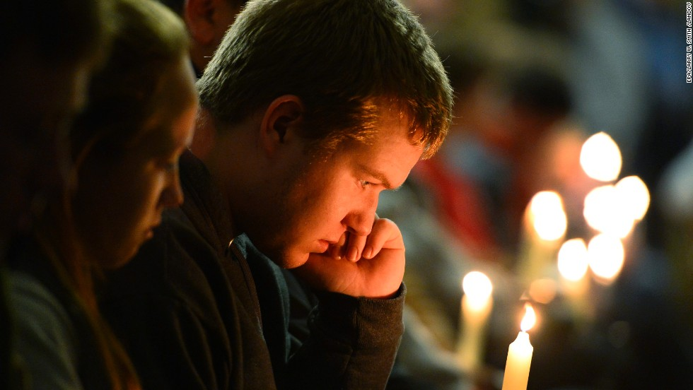 "A young man holds a candle during the vigil.<a href=""http://www.cnn.com/2013/04/18/us/gallery/texas-explosion/index.html""> </a>"