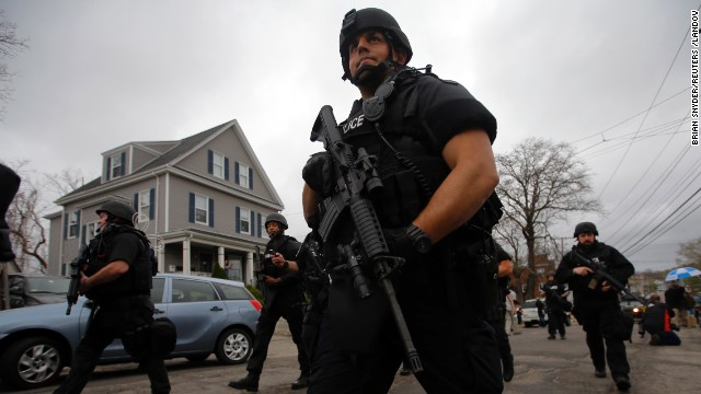Police officers search house to house for the second suspect in the Boston Marathon bombings in a neighborhood of Watertown, Massachusetts April 19, 2013. Black Hawk helicopters and heavily armed police descended on a Boston suburb Friday in a massive search for an ethnic Chechen suspected in the Boston Marathon bombings, hours after his brother was killed by police in a late-night shootout. REUTERS/Brian Snyder (UNITED STATES - Tags: CRIME LAW) REUTERS /BRIAN SNYDER /LANDOV   Photographers/Source: BRIAN SNYDER/Reuters /Landov