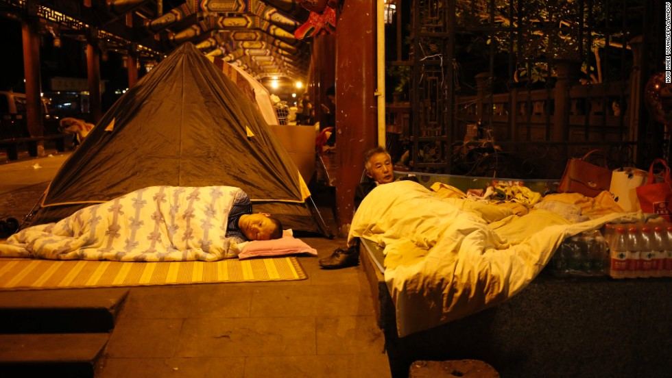 Chinese residents sleep in open areas for fear of aftershocks in Sichuan Province on Sunday.