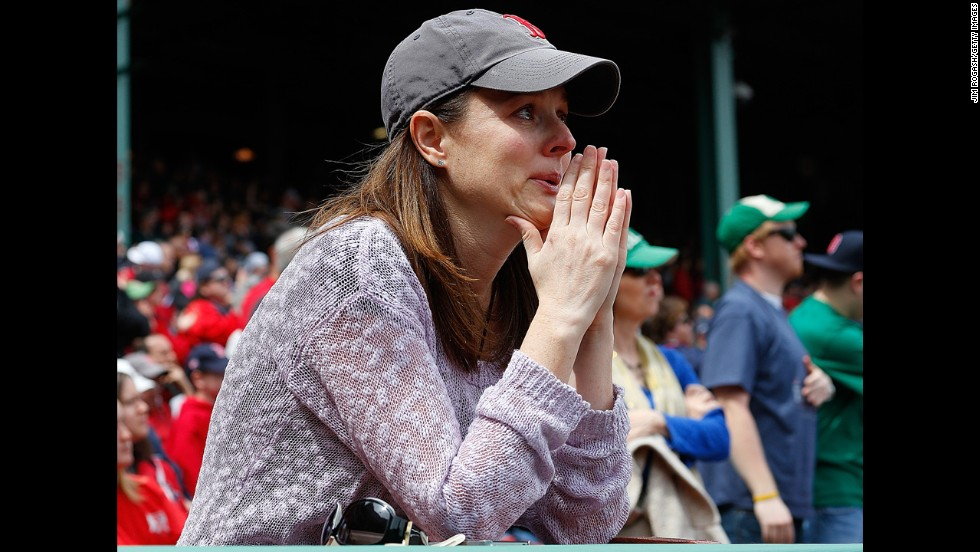 A woman sheds a tear during pregame ceremonies Saturday.
