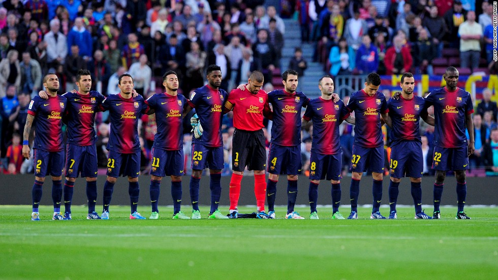 FC Barcelona's players link up during a minute of silence in memory of those killed in the Boston Marathon bombings before the Spanish league football match against Levante UD in Barcelona on Saturday, April 20.