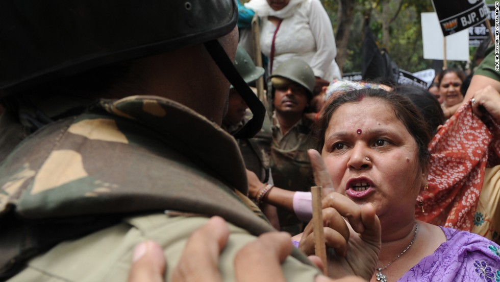 argue with Indian police outside the residence of Sonia Gandhi, chairwoman of the United Progressive Alliance, in New Delhi on Sunday, April 21, at a demonstration against the alleged rape of a 5-year-old girl.