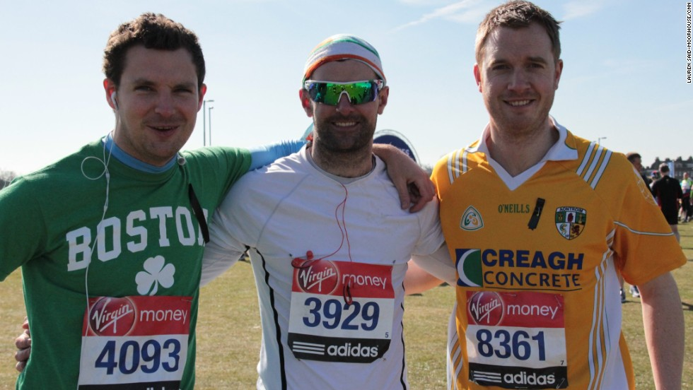 "First time London Marathon runners Barry McCaan, 27, Aidan Savage, 31, Martin Conway, 30 ahead of the race. McCaan told CNN: ""Everyone has been so generous. It totally makes you more determined to show them [the bombers] that terrorism doesn't work."""