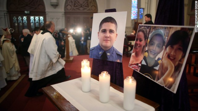BOSTON, MA - APRIL 21:  Photos of the deceased are displayed following Mass at the Cathedral of the Holy Cross on the first Sunday after the Boston Marathon bombings on April 21, 2013 in Boston, Massachusetts. The Mass honored the victims of the bombings and subsequent manhunt as well as first responders.  (Photo by Mario Tama/Getty Images)