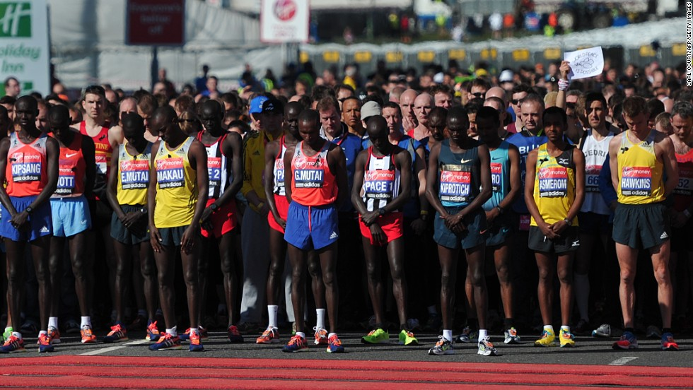 "Runners in the men's elite race of the 2013 Virgin London Marathon observe 30 seconds of silence in honor of the victims of the Boston Marathon bombings before the start of the race in London on Sunday, April 21. People worldwide expressed their condolences after at least three people were killed and scores wounded in two explosions Monday near the finish line of the Boston Marathon. <a href=""http://www.cnn.com/SPECIALS/us/boston-bombings-galleries/index.html"">See all photography related to the Boston bombings.</a>"