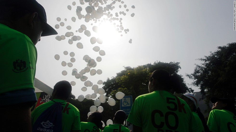 White balloons are released in remembrance of the Boston Marathon bombings victims before the commencement of the 5K San Isidro Run in Lima, Peru, on April 21.