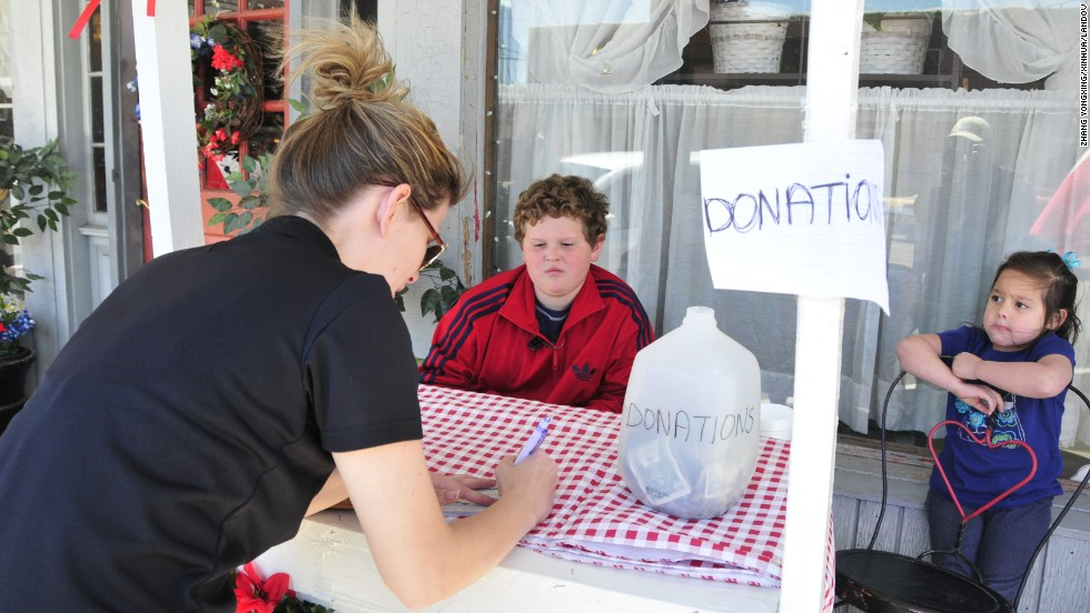 Residents collect donations on Saturday, April 20.