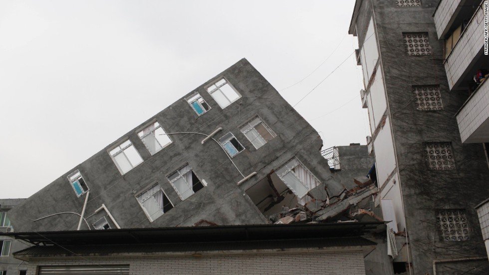 A building in Ya'an is lopsided on Sunday.