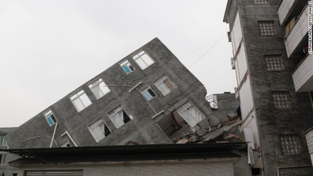 This picture taken on April 21, 2013 shows a damaged building two days after an earthquake hit, in Ya'an City, southwest China's Sichuan province.  Thousands of rescue workers combed through flattened villages in southwest China in a race to find survivors from a powerful quake as the toll of dead and missing rose past 200.      CHINA OUT       AFP PHOTO        (Photo credit should read STR/AFP/Getty Images)