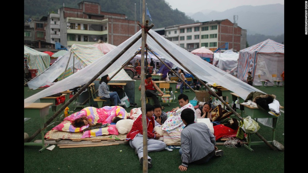 Families rest at an emergency relief center in Ya'an on Sunday.