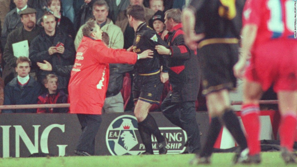 Manchester United's Eric Cantona suffered a moment of madness during an EPL match at Crystal Palace in January 1995.  Cantona had been given a red card for kicking an opponent and, while making his exit from the pitch, the Frenchman jumped over the advertising boards and aimed a scissor kick at a fan who he claimed was shouting insults at him. Cantona was banned for nine months and also served 120 hours community service.