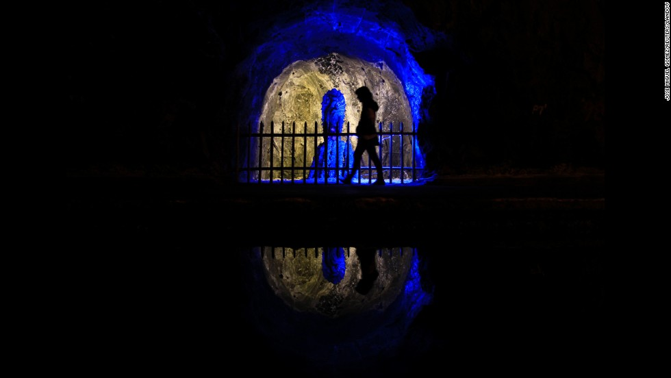 A visitor walks past a statue of the Virgen del Perpetuo Socorro (Our Lady of Perpetual Help) in the Nemocon salt mine in September 2012. The mine is one of Colombia's most popular tourist attractions.
