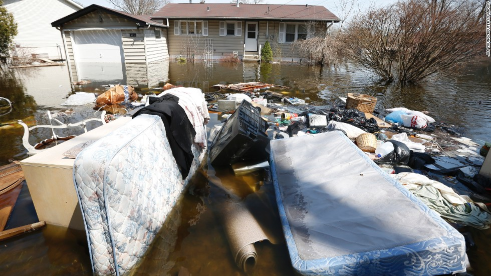 "Household items are submerged in floodwaters in front of a house in Fox Lake, Illinois, on Monday, April 22. Steady rains are expected Tuesday, April 23, in several Midwestern states already facing severe flooding. Have you been affected by the flooding? <a href=""http://ireport.cnn.com/topics/962945"" target=""_blank"">Share your images with CNN iReport</a>."