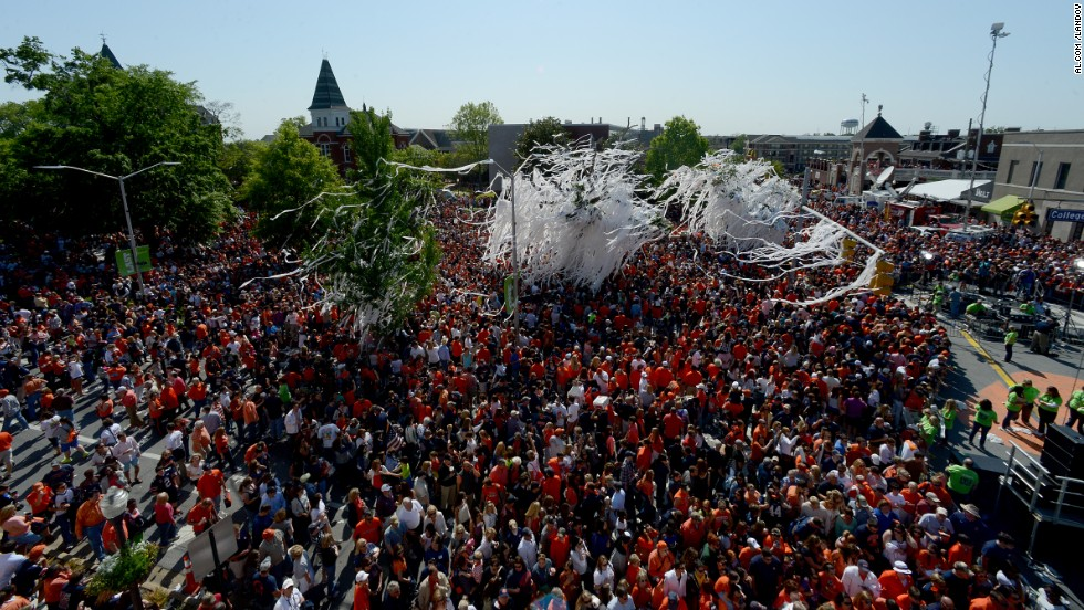 Auburn fans roll the famous oak trees at Toomer's Corner for the last time on Saturday, April 20, after Auburn held its A-Day spring football game.