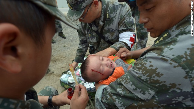 An injured boy receives treatment on April 22, 2013 in Lushan, China.