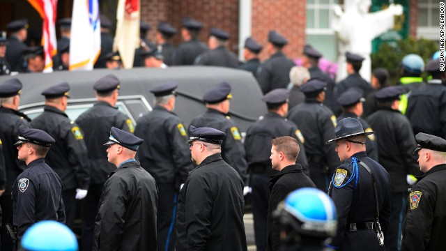 Image #: 22091533    epa03673984 Law enforcement officials enter St. Patrick's Church in formation prior to the funeral for Massachusetts Institute of Technology (MIT) Police Officer Sean Collier in Stoneham, Massachusetts, USA, 23 April 2013. Collier was allegedly shot and killed by Dzhokhar and Tamerlan Tsarnaev on 18 April 2013. Three victims were killed and over 200 were injured on 15 April 2013 in an apparent terrorist attack near the finish line of the 117th Boston Marathon that prompted a intense manhunt for 19 year-old Dzhokhar Tsarnaev who was found hiding in a boat in a backyard.  EPA/CJ GUNTHER /LANDOV