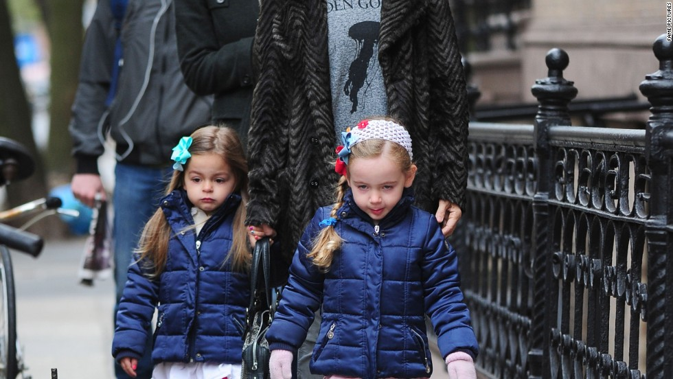 Sarah Jessica Parker goes for a walk with her daughters.