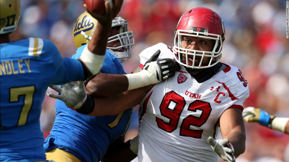 Defensive tackle Star Lotulelei of the Utah Utes battles Torian White of the UCLA Bruins at the Rose Bowl on October 13, 2012, in Pasadena, California.