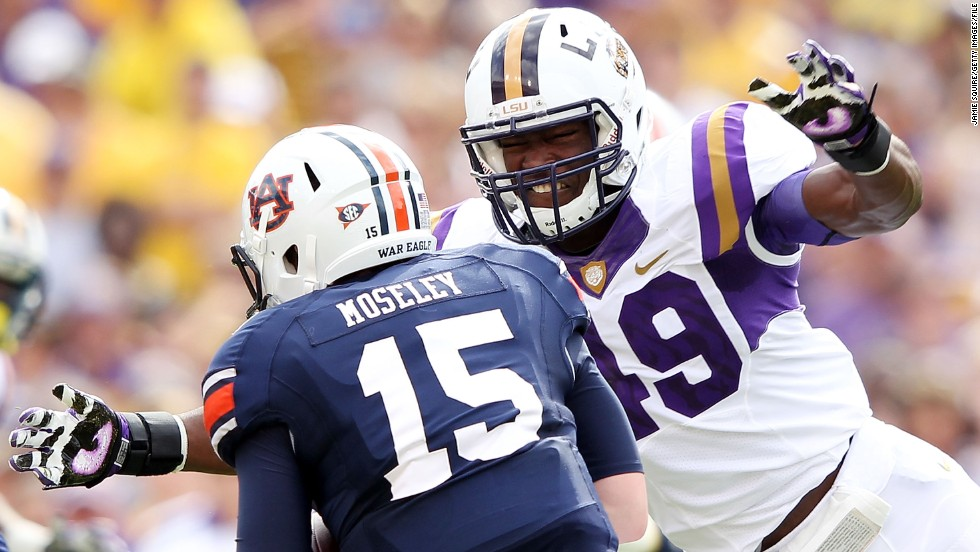 Barkevious Mingo of Louisiana State University sacks quarterback Clint Moseley of the Auburn Tigers on October 22, 2011, in Baton Rouge, Louisiana.