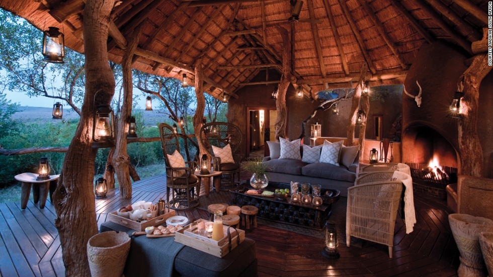 Located in a game reserve, the Madikwe Safari Lodge offers stunning views of passing wildlife amid rustic luxury.