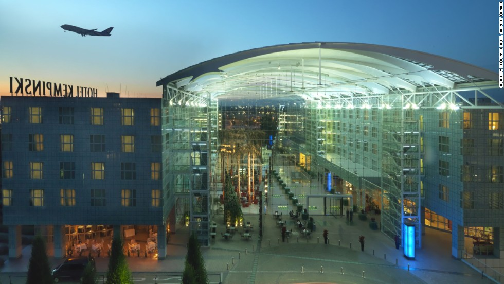 Soundproof windows and blackout curtains help guests disconnect from the busy travel landscape outside at the Kempinski Hotel at the Munich, Germany airport.