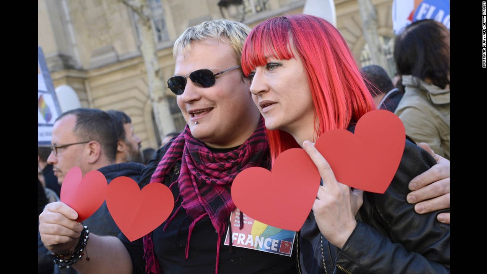 Supporters of same-sex marriage pose for photos during Tuesday's celebrations in Paris.
