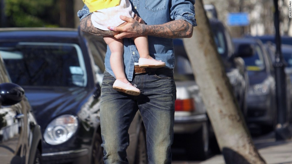 David Beckham takes his daughter for a stroll in London, England.