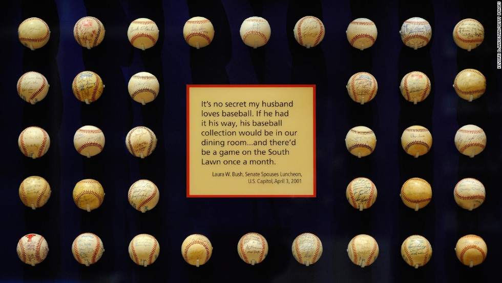 President George W. Bush's baseball collection is on display in the center.