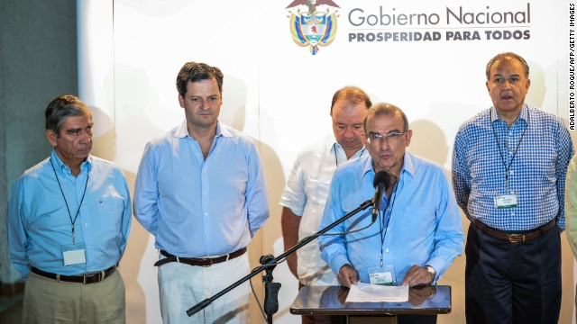 The head of the Colombian government delegation Humberto de la Calle (2nd-R) gives a speech upon arrival for the peace talks meeting with the FARC-EP, on April 23, 2013 in Havana.