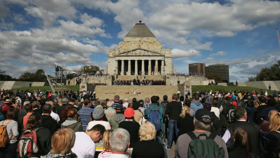 Crowds of people look on at the Shrine of Remembrance on Thursday in Melbourne, Australia.