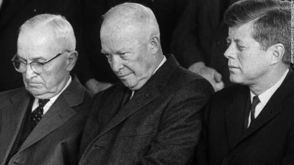 Harry S. Truman, Dwight D. Eisenhower and John F. Kennedy sit together at House Speaker Samuel Rayburn's funeral in November 1961.