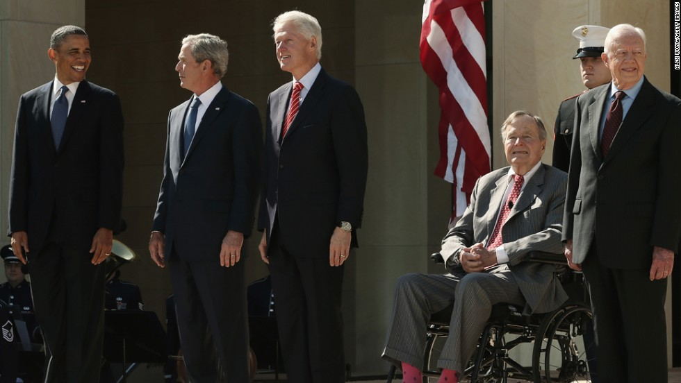 President Barack Obama and former presidents George W. Bush, Bill Clinton, George H.W. Bush and Jimmy Carter arrive on stage for the George W. Bush Presidential Center dedication ceremony in Dallas, on April 25, 2013. Only a few times in history have three or more American presidents been photographed together. Click through to see some of those historic moments.