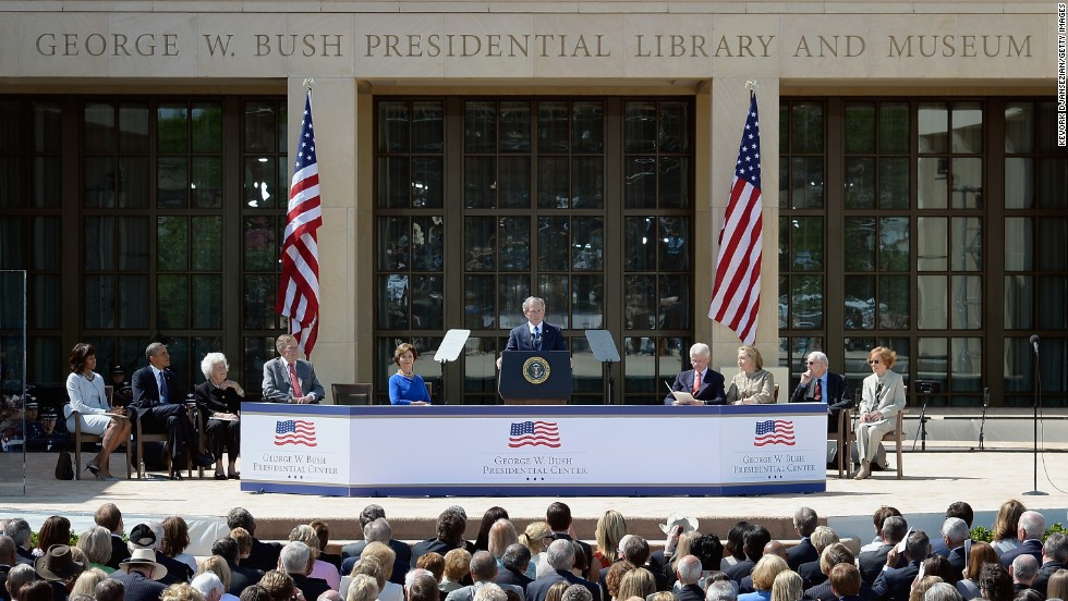 Former president George W. Bush, center, speaks to the crowd at the opening ceremony of the George W. Bush Presidential Center, flanked, left to right, by first lady Michelle Obama, President Barack Obama, former first lady Barbara Bush, former President George H.W. Bush, former first lady Laura Bush, former President Bill Clinton, former first lady Hillary Clinton, former President Jimmy Carter and former first lady Rosalynn Carter.